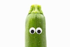 Zucchini z googly oczami na białym tle Obraz Stock