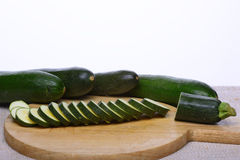 Zucchinis. Arranged on a wooden tray and round slices of zucchini Royalty Free Stock Photos