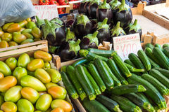 Zucchinis and aubergines for sale Stock Photo
