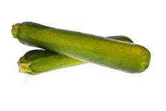 Zucchinis or courgettes isolated on white Royalty Free Stock Photo