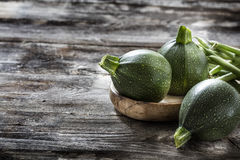 Zucchinis and green beans on old wood for vegetarian cuisine Stock Image