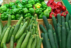 Zucchinis, Peppers, and Cucumbers. Zucchini, pepper, and cucumber vegetables in baskets from a supermarket Stock Image