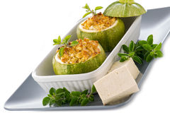 Zucchinis stuffed with tofu cheese Stock Photos