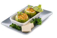 Zucchinis stuffed with tofu cheese Royalty Free Stock Image
