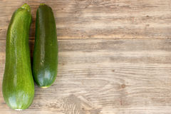 Zucchinis on wood background Royalty Free Stock Photo
