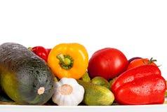 Zucchinizucchini, söt peppar och tomater som isoleras på vit Arkivfoto