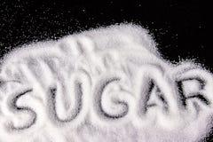 Zucker auf Schwarzem Stockbild