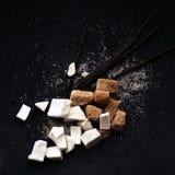 Zucker- und Vanillehülsen lizenzfreies stockfoto