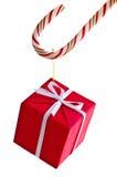 Zuckerstange und Geschenk Stockfotografie