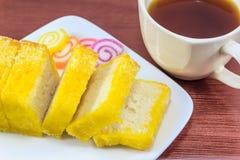 Zuckertoast und Tasse Tee Stockbilder