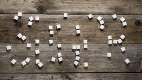 Zuckerwürfel auf Holztisch stock video footage