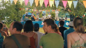 ZUEVKA, UKRAINE- 21 June 2016: Country band play live folk music stock footage