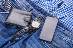 Zufällige Sammlung mit Geldbörse, Telefon und Uhr Lizenzfreie Stockbilder