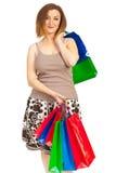 Zufriedene Frau mit Einkaufenbeuteln Stockfotos