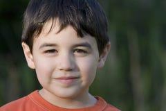 Zufriedener Junge Stockfoto