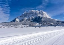 The Zugspitze Massif from the valley of Ehrwald in sunny winter day stock image
