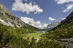 Zugspitze mountain and lake Seebensee, view from Coburger hut, Ehrwald, Tyrol, Austria. Highest mountain in Germany - view from Austria stock photography