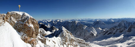 Zugspitze Panorama. Panorama shot of the summit of Zugspitze and a view over the Alps Royalty Free Stock Image