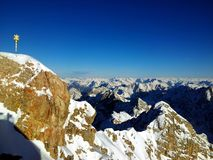 Zugspitze snow mountains with summit cross in Alps at winter, Germany stockbilder