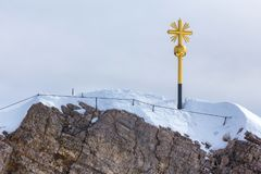 Zugspitze summit cross german alps in the winter. The zugspitze summit cross german alps in the winter Royalty Free Stock Images