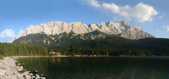 Zugspitze, Waxensteine and lake Eibsee (Germany). The summits of Zugspitze (right, 2963m) and the Waxensteine (left, 2277m) in the german Alps near Garmisch royalty free stock photography