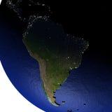 Zuid-Amerika bij nacht op model van Aarde met in reliëf gemaakt land Royalty-vrije Stock Foto's