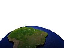 Zuid-Amerika bij nacht op model van Aarde met in reliëf gemaakt land Royalty-vrije Stock Foto
