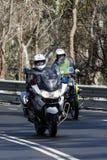 Zuiden Australische Politieman die een BWM-Politiemotorfiets berijden stock foto