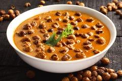 Zuiden Indische cuisine- kulambu van Vatha stock afbeelding