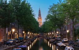 Zuiderkerk from Groenbrugwal canal at night, Amsterdam royalty free stock photo