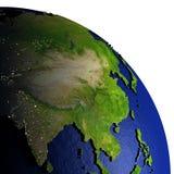 Zuidoost-Azië bij nacht op model van Aarde met in reliëf gemaakt land Royalty-vrije Stock Afbeeldingen