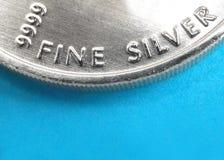 Zuiver zilveren muntstuk stock foto