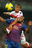 Zuiverloon vies with Keita. Gianni Zuiverloon(L) of Mallorca vies with Seydou Keita(R) of Barcelona in action during the spanish league match at the Nou Camp Royalty Free Stock Photos