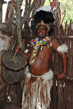 Zulu drummer. LESEDI VILLAGE, SOUTH AFRICA - JANUARY 1: Adult Zulu man, wearing traditional tribal dress with drum on January 01, 2008 in Lesedi African Cultural Royalty Free Stock Image