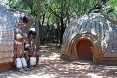 Zulu men wearing warrior dress near tribal straw house, South Africa Royalty Free Stock Photo