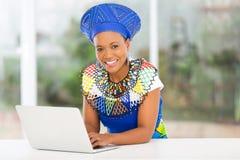 Zulu woman laptop Royalty Free Stock Image
