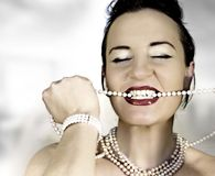 Zum fressen gern. Rich girl with perls an red lips Stock Image