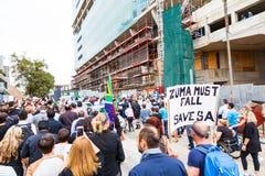 Zuma moet vallen maart Stock Foto