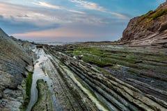 Zumaia flysch coast at sunset Stock Image