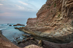 Zumaia flysch coast at sunset Stock Images