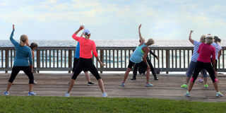 Zumba On The Boardwalk. Women dancing in a Zumba fitness class on the boardwalk of  Deerfield Beach,Florida Stock Images