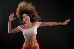 Zumba dance fitness instructor doing sport aerobic exercises. Motivational coach royalty free stock image