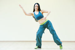 Zumba dancing exercises. Zumba firness instructor doing dancing exercises in sport club Stock Photography