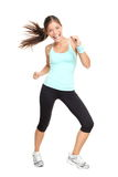 Fitness dance class woman dancing. Dancing fitness woman exercising zumba dance aerobics in full length isolated on white background. Mixed race Asian Caucasian Stock Photos