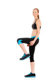 Zumba fitness woman. Wearing black and blue workout clothing Stock Image