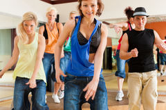 Zumba or Jazzdance - people dancing in studio Royalty Free Stock Photography