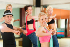Zumba or Jazzdance - young people dancing in studio stock photos