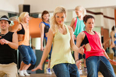 Zumba or Jazzdance - young people dancing in studio royalty free stock photos