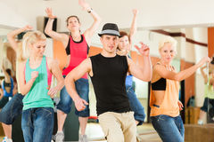 Free Zumba Or Jazzdance - Young People Dancing In Studio Royalty Free Stock Photos - 35771598