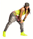 Zumba salsa dancer, smiling man. Urban street style. On white background. Young, smiling and handsome latin man with tattoos. Dancer leaning with both hands on Royalty Free Stock Image